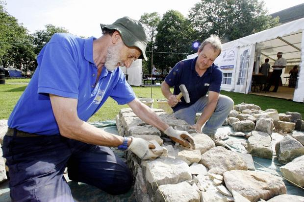 Richard Kitchen (left) and Gordon Simpson show the art of dry stone walling in Keighley