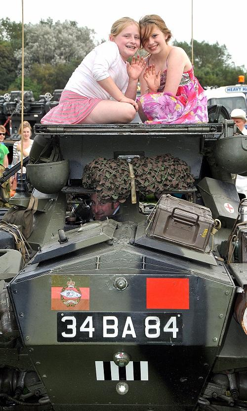 Karagh, nine, and Rebekah Dixon, 11, with their dad's 1953 Ferret Scout Car at Otley Vintage Transport Extravaganza