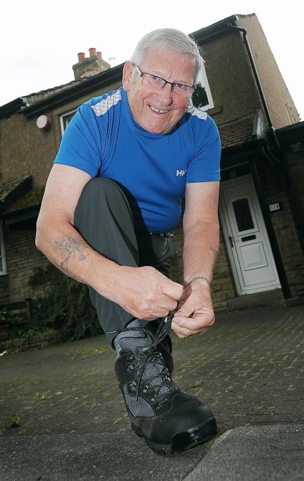 TRIBUTE: Bill Vaines putting his walking boots on ahead of the sponsored walk  in memory of his wife Carol
