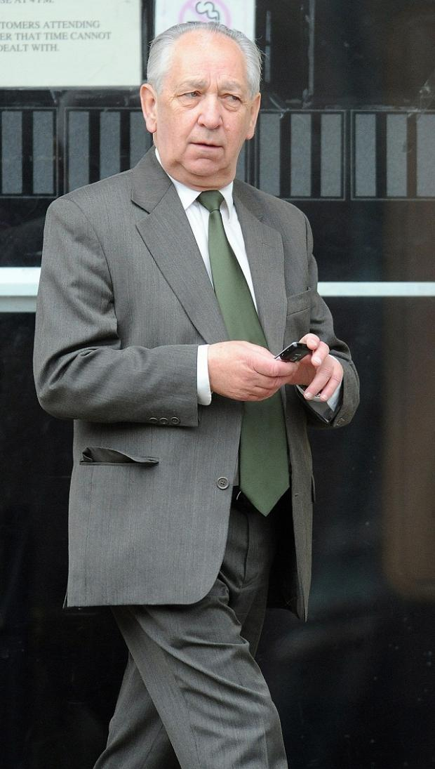 Peter Merrick leaves court after an earlier hearing