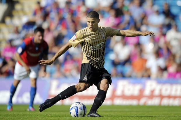 A specialist has assured Nahki Wells he will not aggravate his hip injury by playing against Barnet and Morecambe