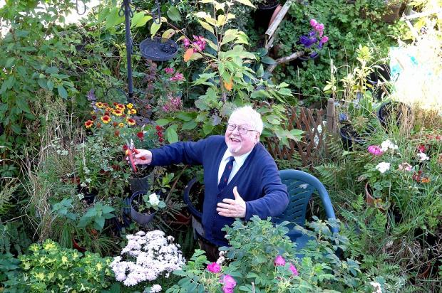 David Sugden tends to the blooms in his award-winning garden