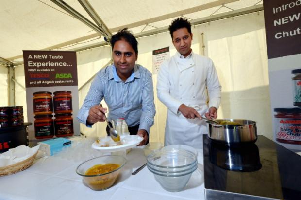 Tahir Iqbal and Wasim Aslam at the Aagrah tent at the Saltaire Festival.