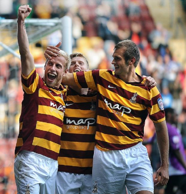 Andrew Davies celebrates alongside fellow City scorers Alan Connell and James Hanson after making it 3-0 against Barnet