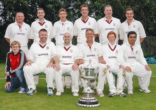 Delighted Woodlands players show off the Bradford League trophy – Picture: JCT600 Bradford League