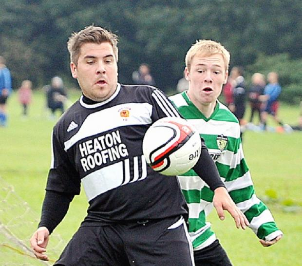 Chris Brayne of Red Lions getas ahead of Swaine Green opponent Gary Sunderland
