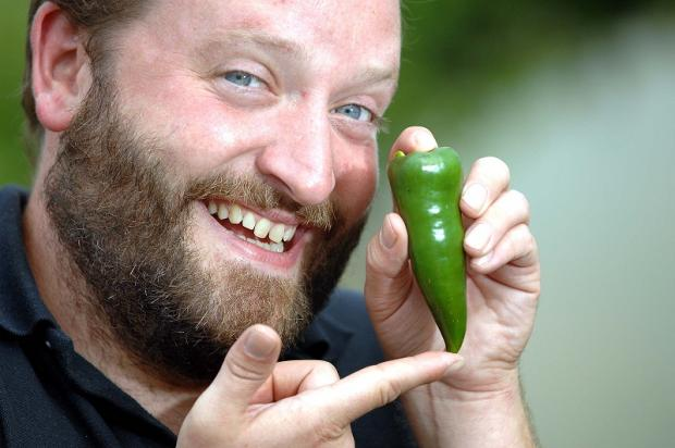 Paul Kilgallon with one of the chillies which have been grown at the City Farm project