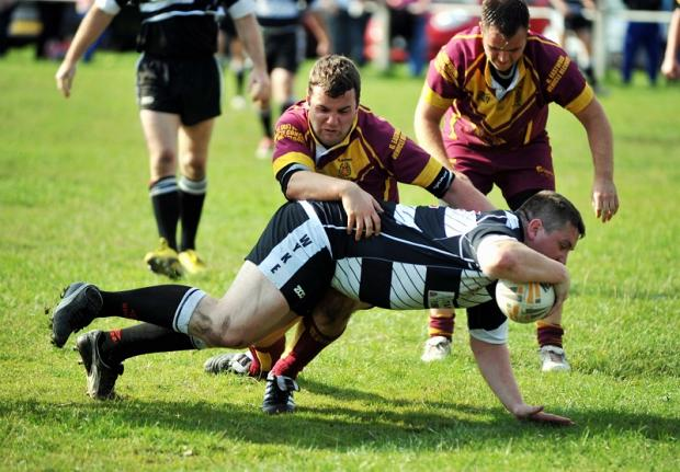 Ian Wormald dives over for another Wyke try at Clayton
