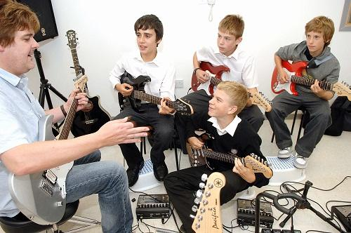 KEY DECISION: Darren Dutson leads a guitar class at the newly-refurbished Yorkshire Music School