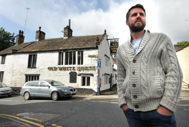 New leaseholder Roy Davison outside the Old White Horse pub in Bingley