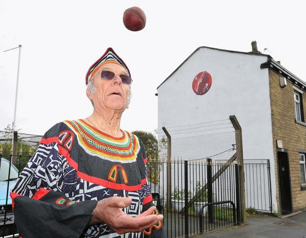 Barry Langroyd Hanson with the cricket ball painted on his wall