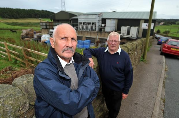 Harecroft resident David Driver (left) and Councillor Mike Ellis outside the slaughterhouse