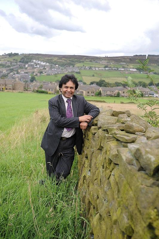 Pervez Abbas, pictured in 2008, stands on the site of the proposed development in Weavers Hill, Haworth