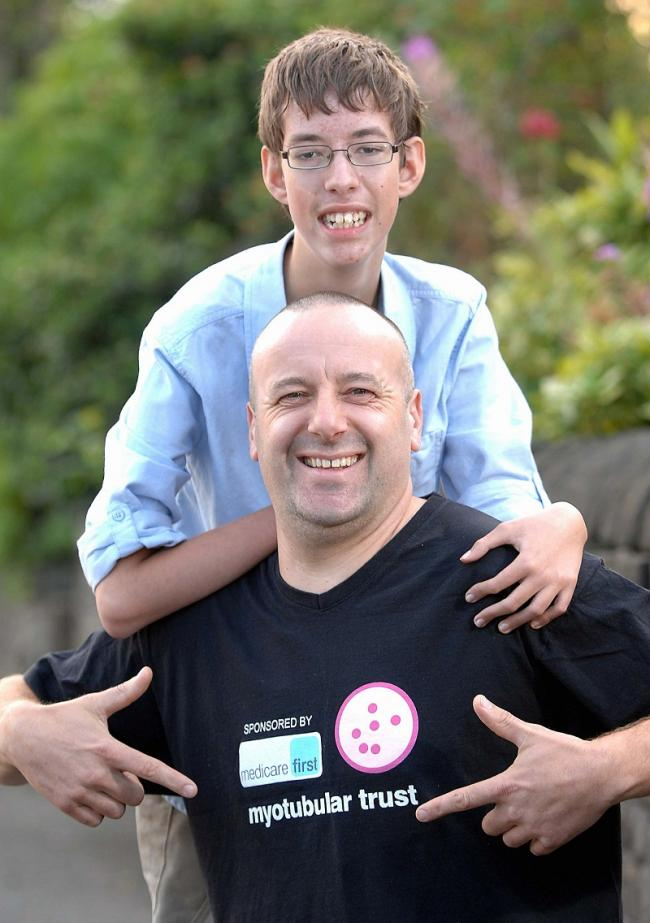 Tony Handy, pictured with 14-year-old Harry Beck, is running the Kielder Marathon to help the Myotubular Trust