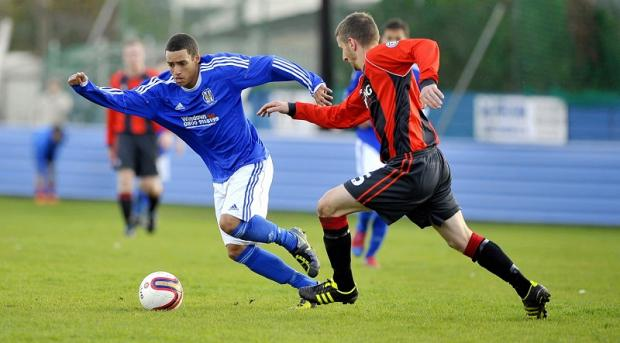 Eccleshill's Brandon Roane gives Bottesford's Carl La Rocca the slip