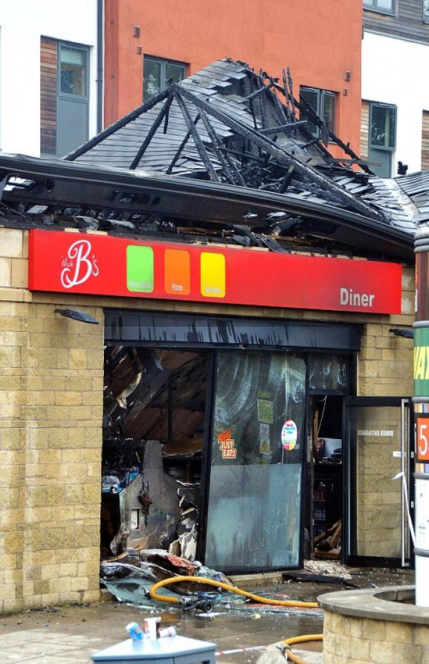 The aftermath of the blaze at Uncle B's takeaway this evening