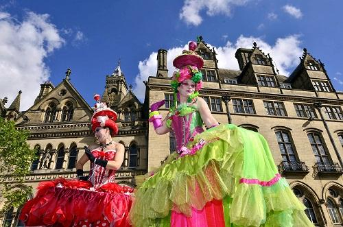 Bradford Telegraph and Argus: Street entertainers perform at the World Curry Festival
