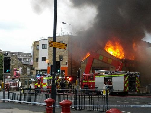 Flames can be seen shooting through the roof of Uncle B's takeaway in Great Horton Road in this picture sent in by a reader