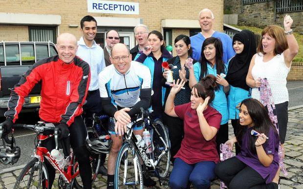 EVENT: Mark Ray completes a bike ride at Ravat and Ray Dental care in Manningham with Andy Wilshaw and colleagues