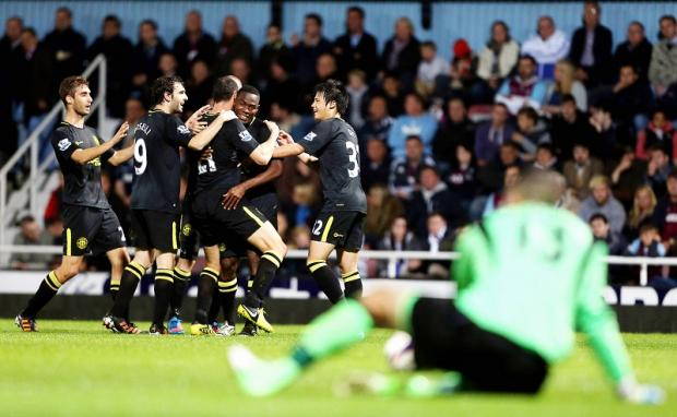 Ivan Ramis is mobbed by his team-mates after scoring Wigan's second goal in their 4-1 third-round victory over West Ham on Tuesday