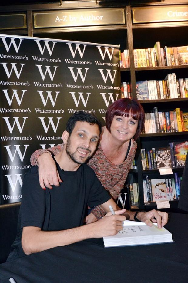 THAT'S MY BOY: Proud mum Nicky Goodwin with son Dynamo signing copies of his autobiography in Waterstones
