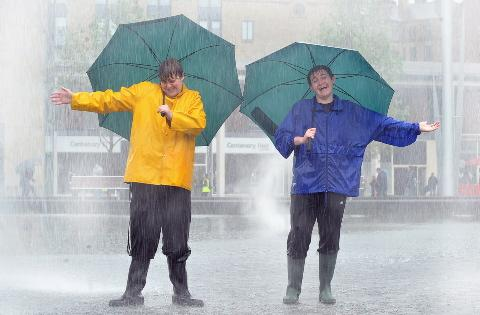 Singing in the rain in Bradford city park