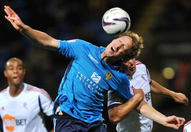 Luciano Becchio's sixth successful penalty of the season moved Leeds United up to eighth