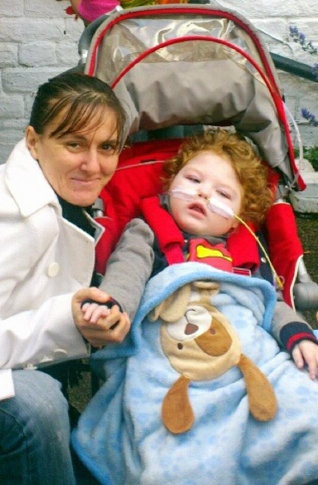 Andrea McKenzie-Moore with her two-year-old son Dylan, who died from pneumonia in July