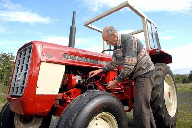 Farmer John Gullett with his renovated his International Harvester tractor