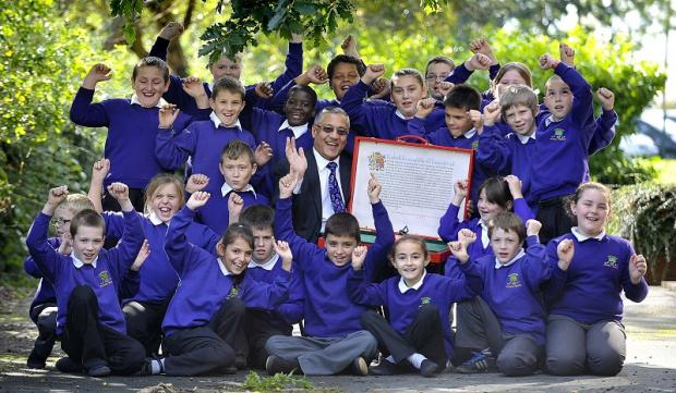 Patel with pupils at Carrwood Primary School