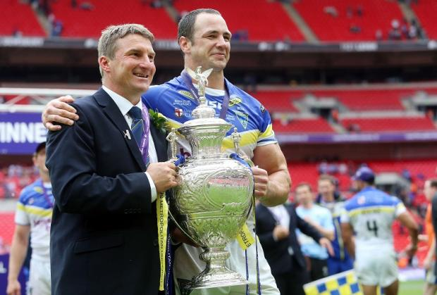 Tony Smith and Adrian Morley show off the Challenge Cup, with Warrington favourites to add the Grand Final trophy to their 2012 haul tonight