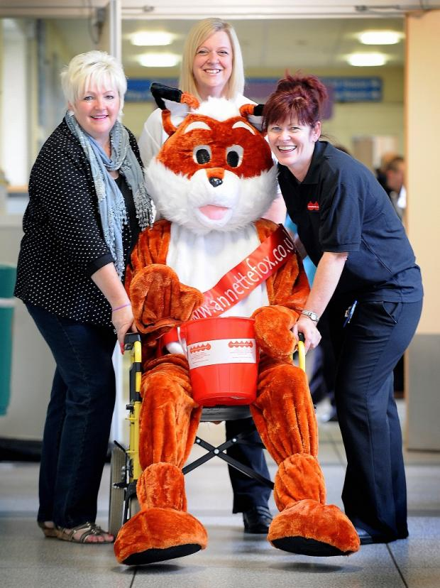 Josie Buckley, Michelle Adam and Shirley Taylor with the Mr Fox mascot