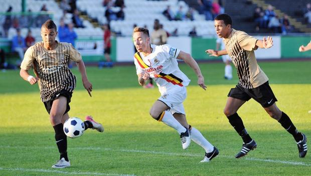 Forrayah Bass, left, went close to putting Bradford City 2-0 ahead with a glancing header