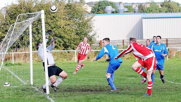 Tyersal keeper Martyn Glenn thwarts another Fryston raid