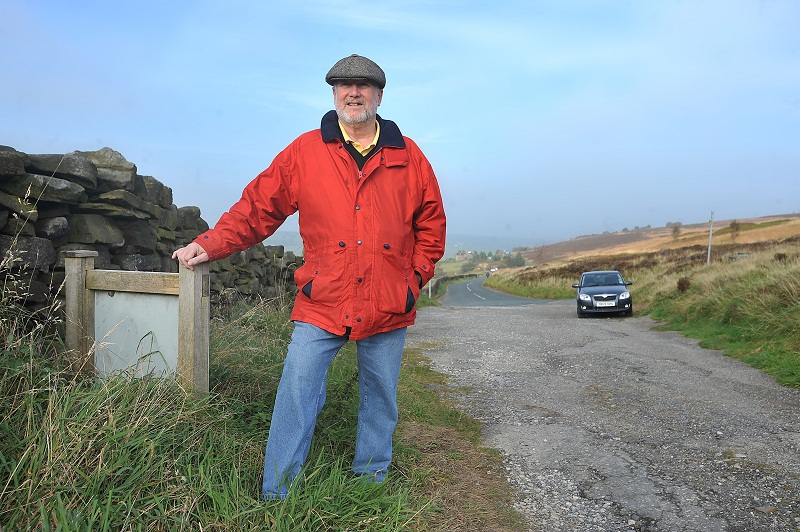 John Huxley in a car park overlooking Stanbury