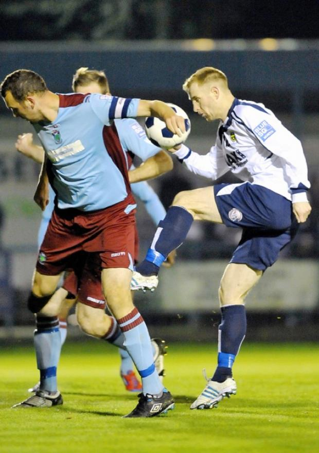 CUP OF CHEER: James Walshaw, right, vies for possession during Guiseley's 3-1 cup win over Colwyn Bay in midweek