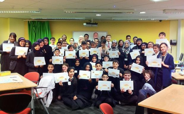 Students who took part in the enterprise challenge with Apprentice star Adam Corbally (centre, back)