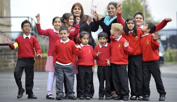 From left, head teacher Shanaz Anwar-Bleem and learning mentor Ruby Hussain celebrate with some of the school's pupils