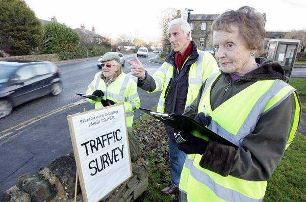Parish councillors carry out a survey of vehicles  in the area as part of their efforts to stop the scheme