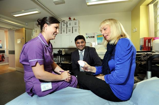 Sister Laura Walker, Dr Dinesh Saralaya and patient Julie Fairhurst