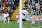 Super sub Zavon Hines slots the ball past York goalkeeper Michael Ingham to rescue a point for City at Valley Parade