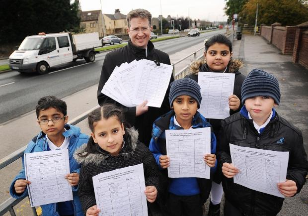 St Matthews head teacher Bob Curran and pupils Rameez Shazad, Ibraheem Ayoub, Hena Hussain, Hira Yusuf and Reece Falcus with the petition