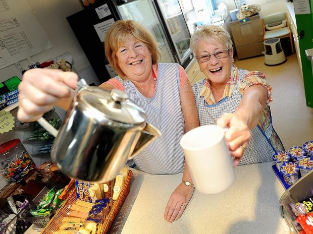 Hospital volunteers Margaret Cohen and Nora Hurley serve drinks at a shop in Bradford Royal Infirmary