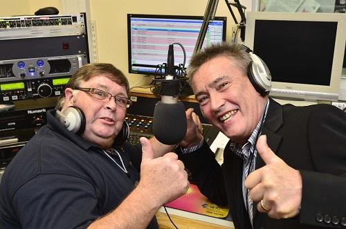 THUMBS-UP: Radio Royal chairman George Sumner and panto star Billy Pearce share the good news with listeners