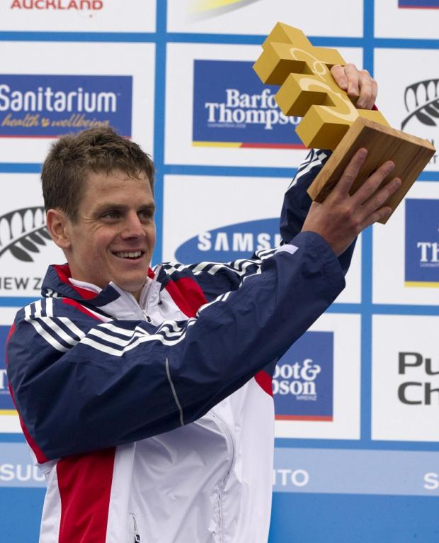 Jonny Brownlee shows off his trophy after being crowned world triathlon champion