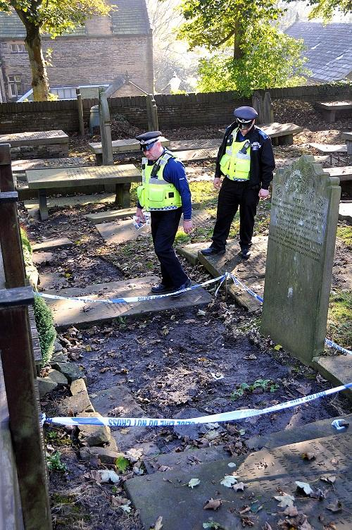 Police at St James Church, Thornton, where thieves have stolen historic gravestones
