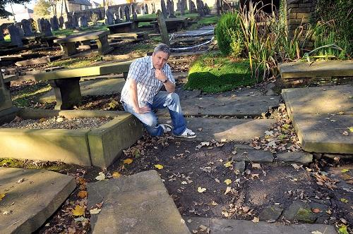 LOST FOR WORDS: Churchwarden Steven Stanworth at at the site where the gravestones were stolen from the churchyard of the Bronte Bell Chapel
