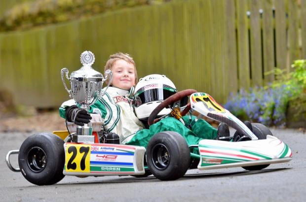 Wrose youngster Archie Kitching shows off his Bambino Kart Club trophy