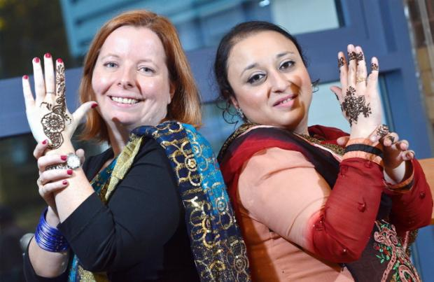 Horton primary teachers Tania Ackernley and Naghmana Azad prepare mehndi art