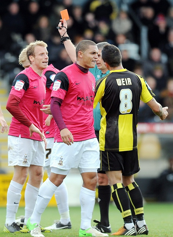 Nathan Doyle confronts Burton opponent Robbie Weir as referee Andy D'Urso shows Ricky Ravenhill a red card